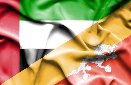 emirates: Waving flag of Bhutan and United Arab Emirates Stock Photo