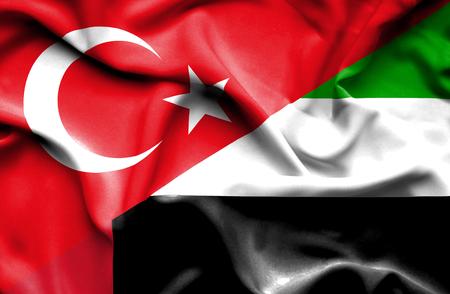 emirates: Waving flag of United Arab Emirates and Stock Photo