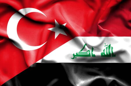 iraq conflict: Waving flag of Iraq and Stock Photo