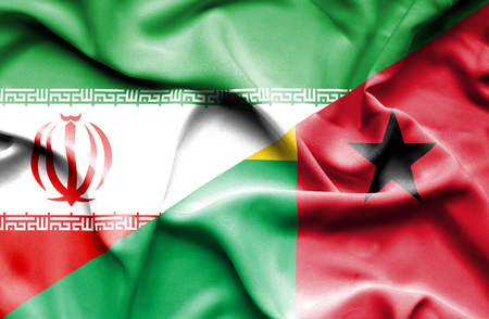 bissau: Waving flag of Guinea Bissau and Iran