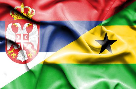 principe: Ondeando la bandera de Santo Tom� y Pr�ncipe y Serbia Foto de archivo