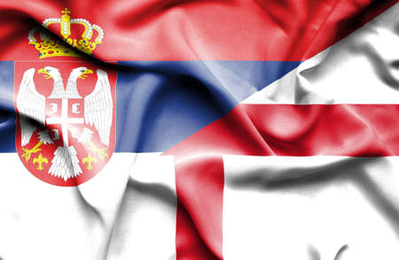 serbia: Waving flag of England and Serbia Stock Photo
