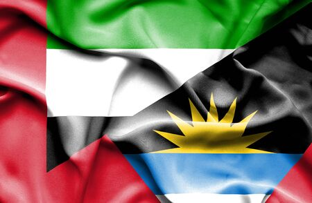 antigua: Waving flag of Antigua and Barbuda and United Arab Emirates Stock Photo