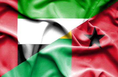 guinea bissau: Waving flag of Guinea Bissau and United Arab Emirates