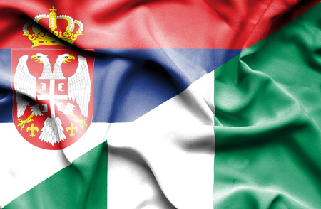 serbia: Waving flag of Nigeria and Serbia Stock Photo