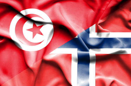 norway flag: Waving flag of Norway and Tunisia Stock Photo