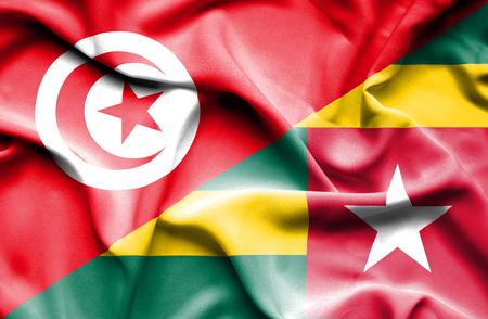 togo: Waving flag of Togo and Tunisia