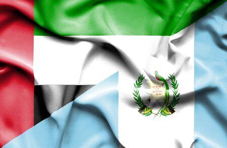 guatemalan: Waving flag of Guatemala and United Arab Emirates Stock Photo