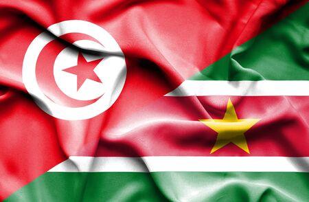 tunisia: Waving flag of Suriname and Tunisia