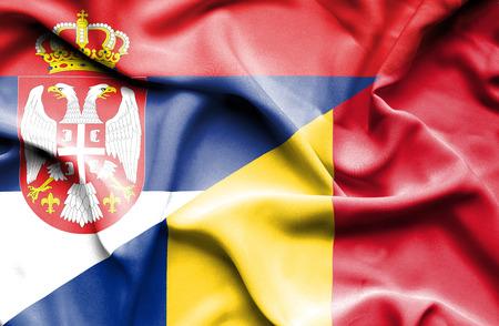 serbia: Waving flag of Romania and Serbia Stock Photo