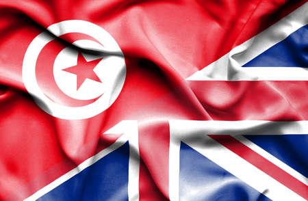 tunisia: Waving flag of United Kingdom and Tunisia