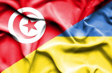 tunisia: Waving flag of Ukraine and Tunisia