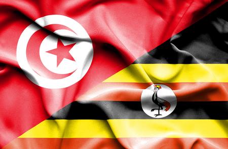 tunisia: Waving flag of Uganda and Tunisia