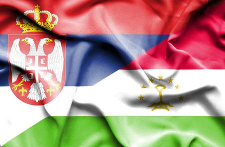 tajikistan: Waving flag of Tajikistan and Serbia Stock Photo