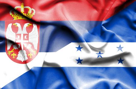 serbia: Waving flag of Honduras and Serbia Stock Photo