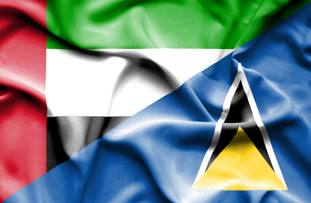 st lucia: Waving flag of St Lucia and United Arab Emirates Stock Photo