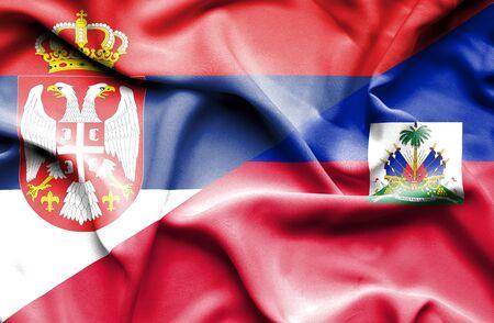 haiti: Waving flag of Haiti and Serbia Stock Photo