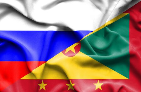 guernsey: Waving flag of Guernsey and Russia Stock Photo