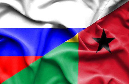 bissau: Waving flag of Guinea Bissau and Russia
