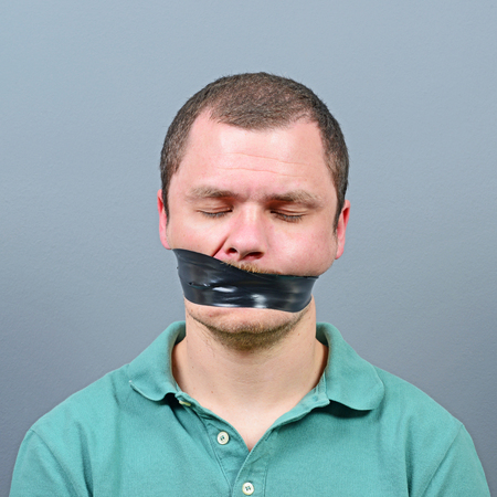 Kidnapped man with tape over his mouth