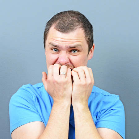 obsessive compulsive: Man biting his nails - Bad habit concept