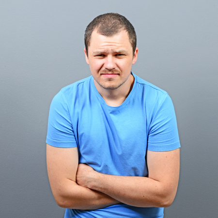 constipation symptom: Portrait of a man suffering from stomach pain Stock Photo