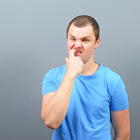 habit: Man biting his nails - Bad habit concept