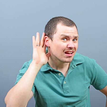 secretly: Portrait of handsome man secretly listening on private conversation Stock Photo