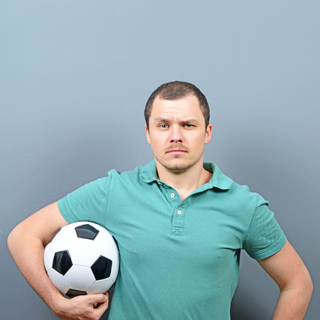 supporter: Portrait of man holding football - Football fan supporter or player concept Stock Photo