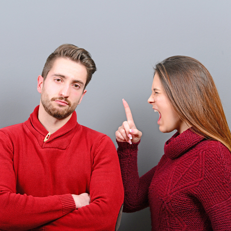 behaving: Man doenst care she is screaming at him and behaving tolerant Stock Photo