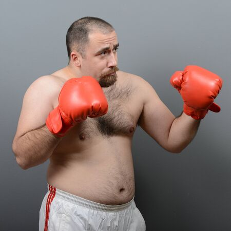 hairy: Portrait of funny fat boxer against gray background Stock Photo