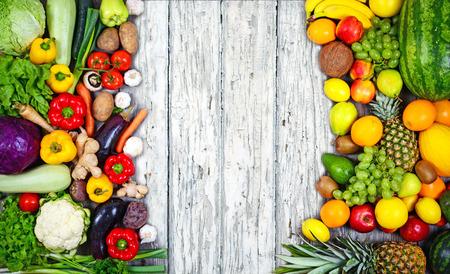 Huge group of fresh vegetables and fruit on wooden background - Vegetables VS Fruit - High quality studio shot