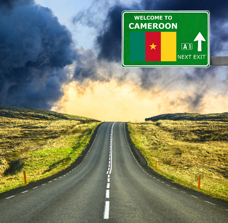 cameroon: Cameroon road sign against clear blue sky Stock Photo
