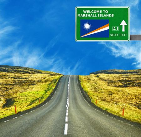 marshall: Marshall Islands road sign against clear blue sky