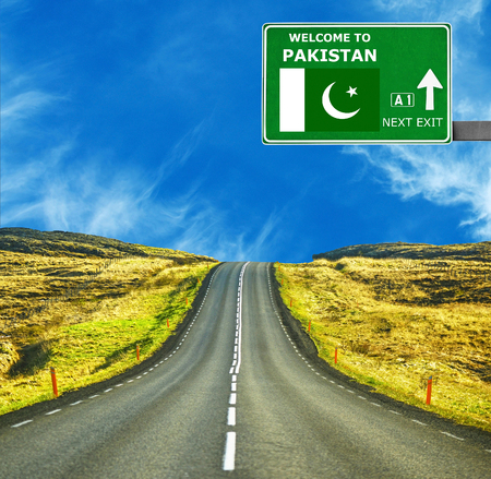 Pakistan road sign against clear blue sky