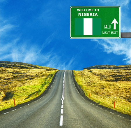 country nigeria: Nigeria road sign against clear blue sky