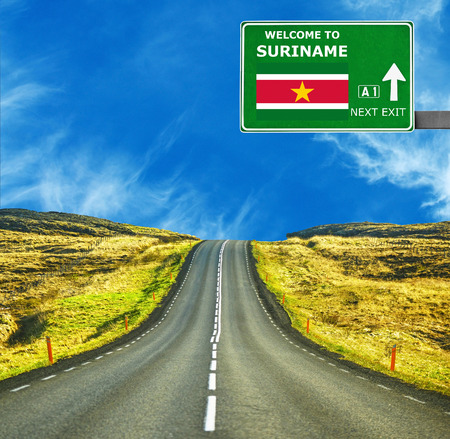suriname: Suriname road sign against clear blue sky Stock Photo