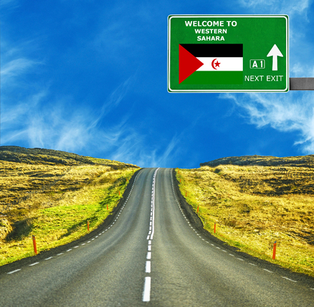 Western Sahara road sign against clear blue sky