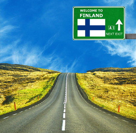 Finland road sign against clear blue sky Stock Photo