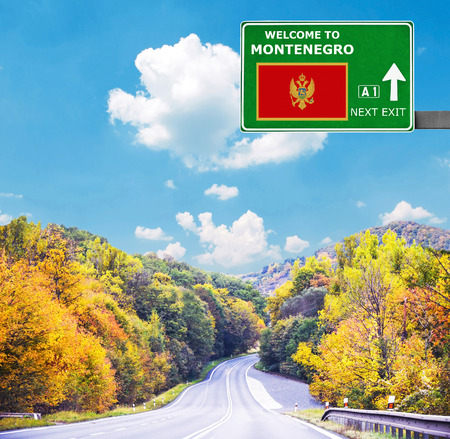 Montenegro road sign against clear blue sky Stock Photo