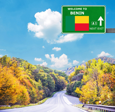 Benin road sign against clear blue sky Stock Photo
