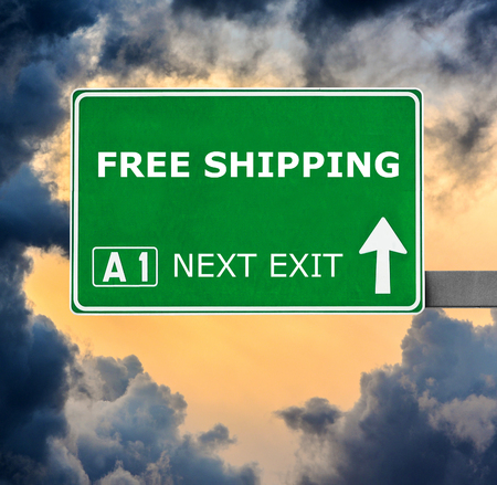 enticement: FREE SHIPPING road sign against clear blue sky
