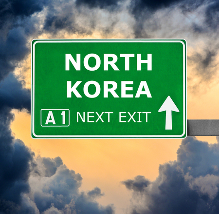 north korea: NORTH KOREA road sign against clear blue sky Stock Photo