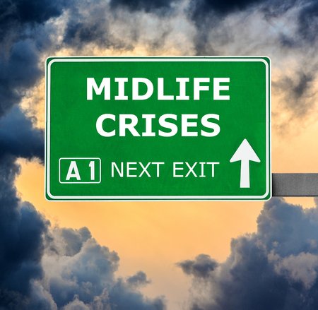 midlife: MIDLIFE CRISES road sign against clear blue sky