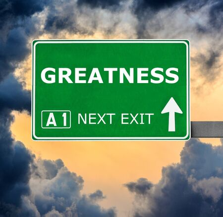 greatness: GREATNESS road sign against clear blue sky Stock Photo