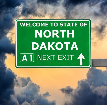 north dakota: NORTH DAKOTA road sign against clear blue sky Stock Photo