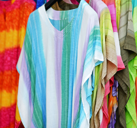 closet rod: Colorful shirts for sale in outdoor market