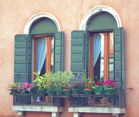 Balcony filled with various beautiful flowers Archivio Fotografico