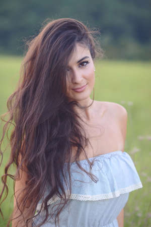 Portrait of beautiful young woman with lon hair enjoying nature Stock Photo