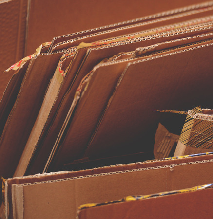 original ecological: Stack of used cardboard ready for recycling Stock Photo